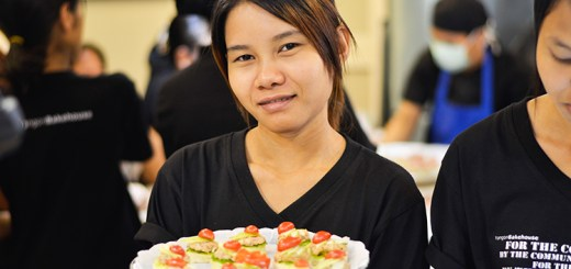Woman holding a plate of food.