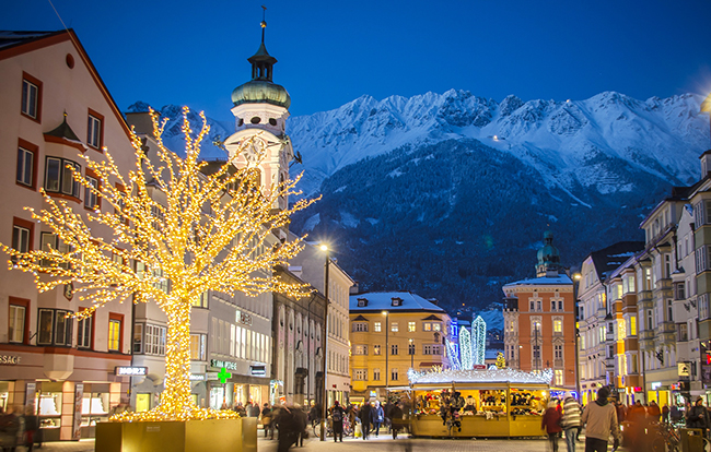 Christmas lights in Innsbruck's Christmas market, with impressive Alpine peaks in the background