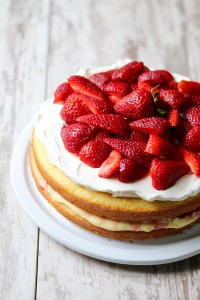 Layer cake with cream and strawberries