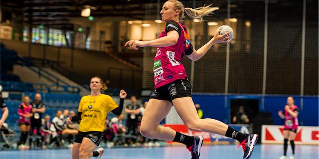 Kristiansand Vipers handball player prepares to throw