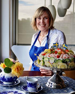 Chef Carina Johnsson stands by her seafood smörgåstårta