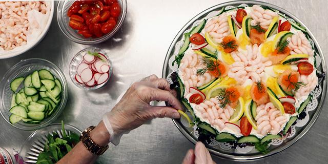 a seafood smörgåstårta being put together