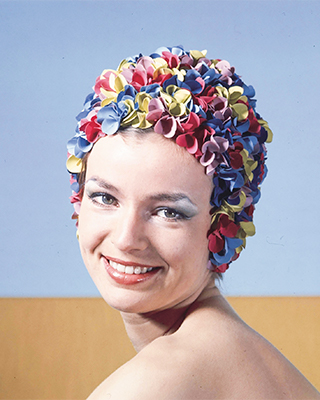 A woman in a colorful latex bathing cap