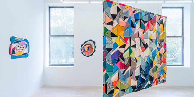 A hanging geometric colorful weaving by Sissel Blystad