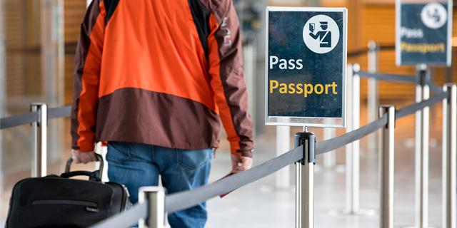 a man walking towards passport control
