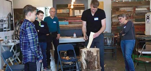 Erik Vevang teaches a small group of students carving techniques