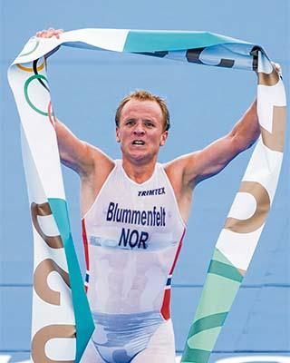 Gold medal winner Kristian Blummenfelt celebrates his crossing the finish line first