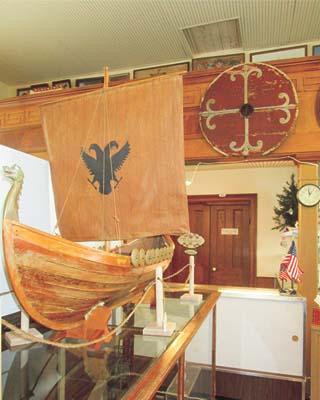 a wooden Viking ship model