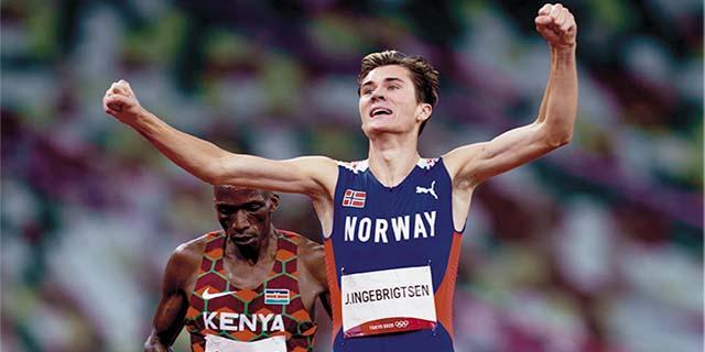 Gold medal winner Jakob Ingebrigtsen celebrates his gold medal