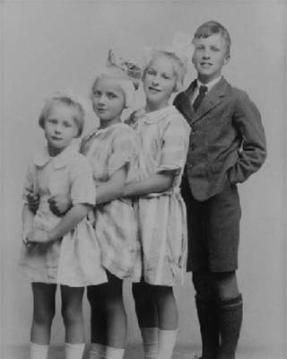 a young Roald Dahl with his three sisters