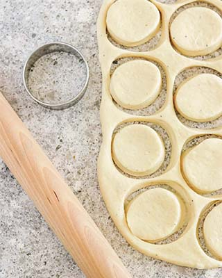 skoleboller dough cut out with a biscut cutter and a rolling pin