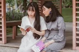 two-women-reading-together