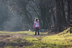 girl-child-standing-in-the-forest