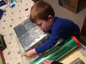 Declan helped wrap photo albums.