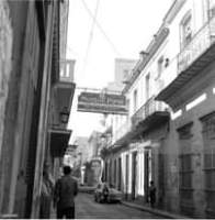 May be a black-and-white image of one or more people and street
