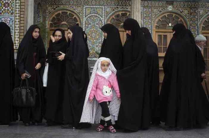 Voters line up to cast their ballots at a polling station in the city of Qom, Iran. Elections for Iran's parliament (Majlis) and Assembly of Experts kicked off on Friday, Feb. 26, 2016. (Ahmad Halabisaz/Xinhua via ZUMA Wire)