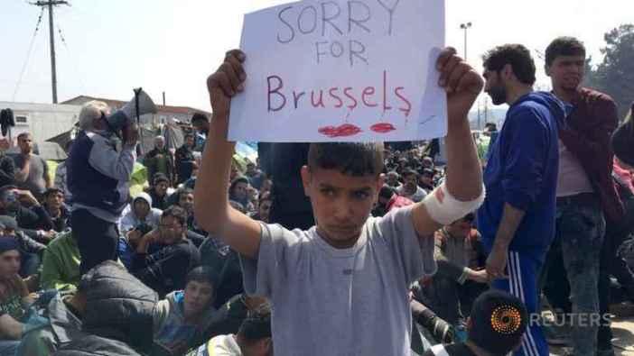 a-refugee-boy-holds-up