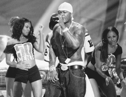 50 Cent performs at the 2003 BET Awards. AP/Wide World Photos. Reproduced by permission.