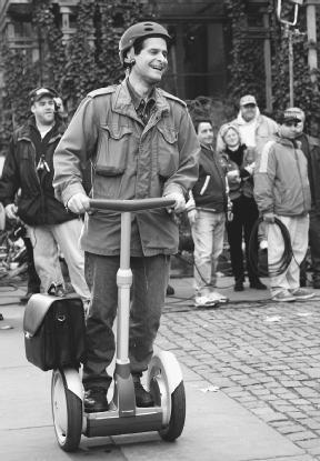 Dean Kamen rides his invention, the Segway Human Transporter. AP/Wide World Photos. Reproduced by permission.