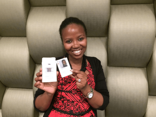Zimkhita Buwa holding her card, the 7 of diamonds.