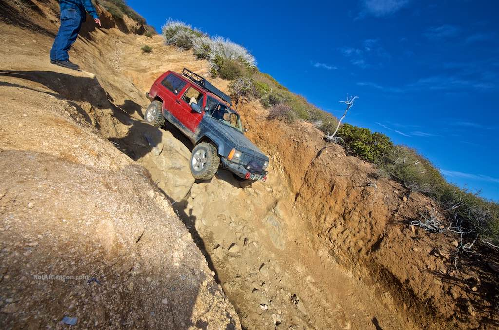 Jeep coming off a steep ledge