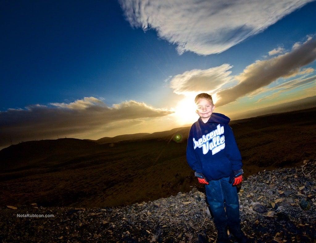 Little boy at sunset above Oro Grande
