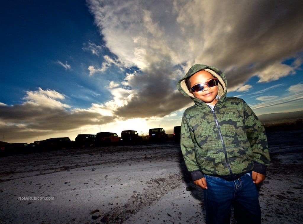 Little boy looking cool at sunset in the hills above Oro Grande, CA