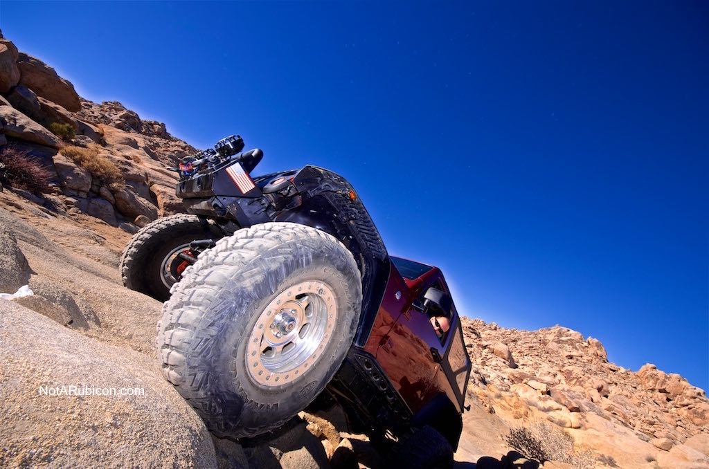 Jeep on a rock at Cougar Buttes