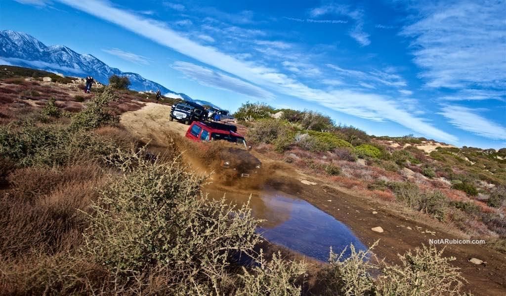 Jeep Cherokee in mud on Cleghorn Ridge trail