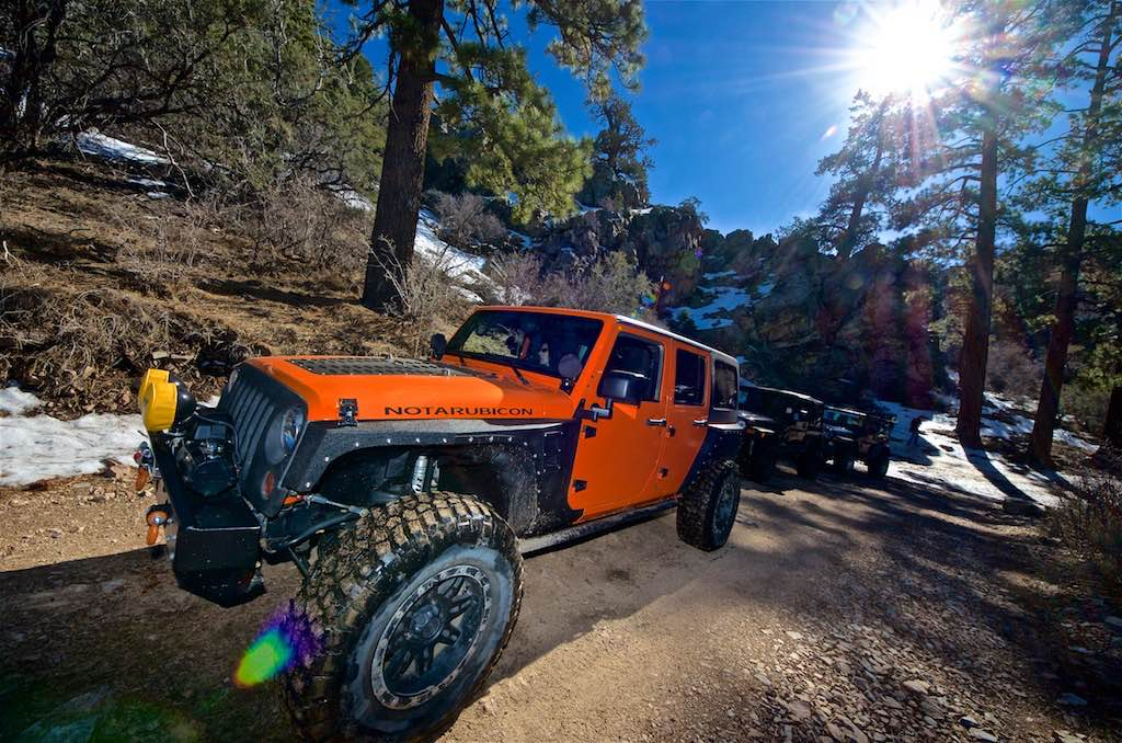 The orange Jeep NotARubicon in the snow on the Gold Mountain off-road trail