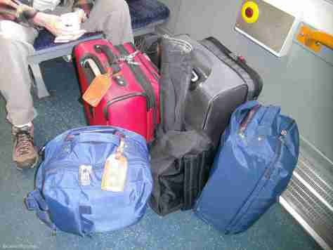1 LARGE, 1 SMALL CARRY-ON EACH, MY RUCKSACK & TRAVEL GUITAR