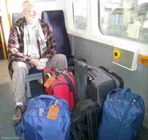 ALL OUR BAGS: 2 CARRY-ONS EACH, CHRIS'S RUCKSACK & TRAVEL GUITAR