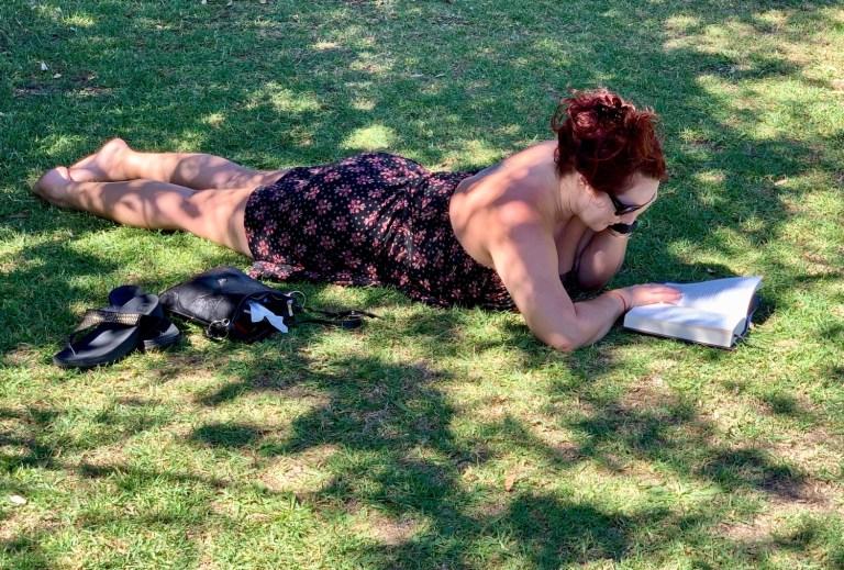 prone woman reading