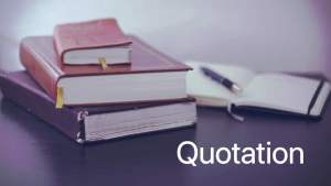 stack of books and open notebook. Label: Quotation