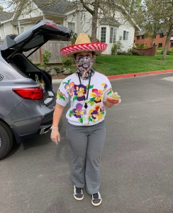 woman wearing sombrero and carrying guacamole and salsa
