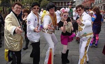 New Orleans Mardi Gras. Costumed revelers in J...