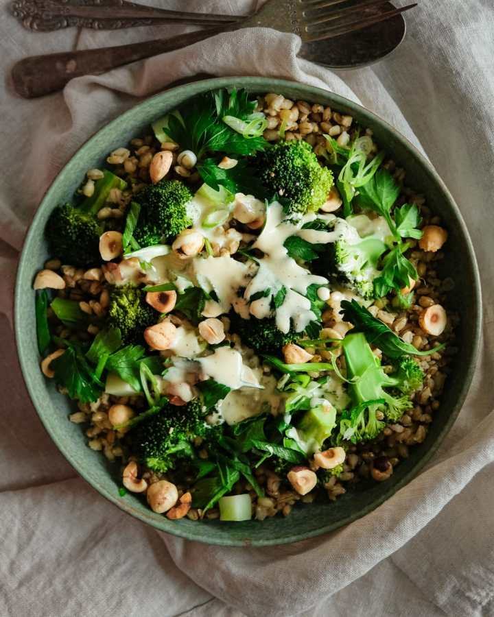 barley broccoli salad with tahini dressing from above close up