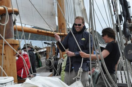 Bill getting ready to hoist a sail