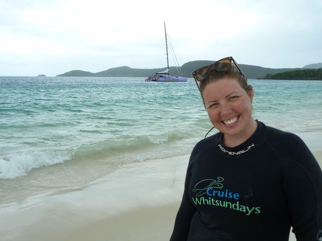 Eva on Whitehaven beach with the Camira in the background