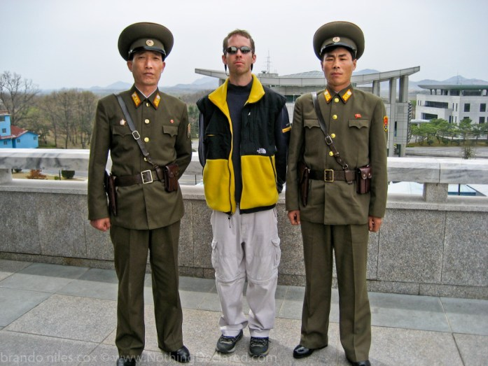 Author: Brandon Cox and two North Korean Generals at the DMZ Joint Security Area.
