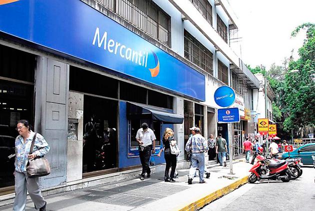 Banco Mercantil anunció eliminación de programación de transferencias y pagos en línea por reconversión