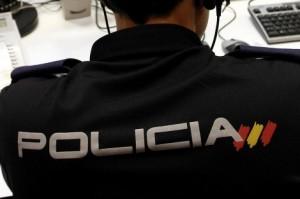 policia espalda