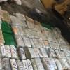 Decomisan cargamento de dinero; dos detenidos