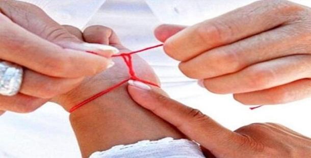Fio vermelho no pulso: Saiba todos os segredos do amuleto mais potente.