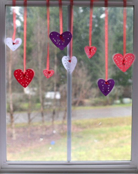 hole punch hearts in window