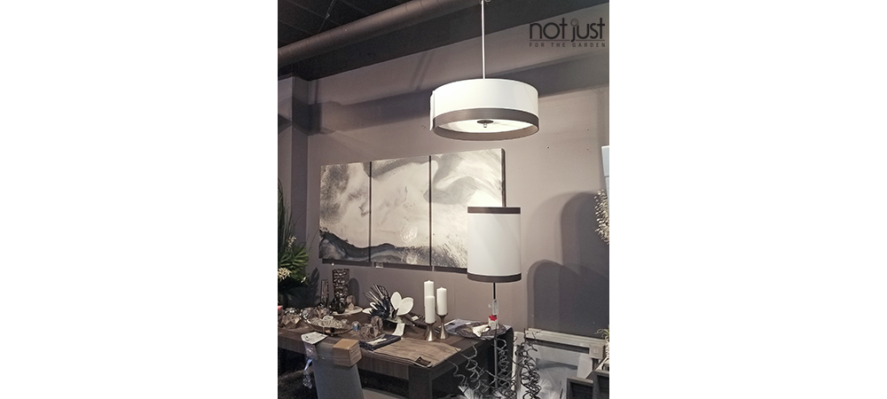 Canadian made pendant/ceiling light with white shade and pewter metal hung over a dining room in a home decor setting