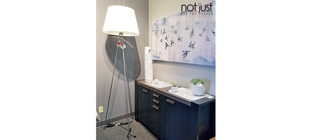 Origina Canada tripod floor lamp with white shade and pewter base next to canvas art and console in home decor setting