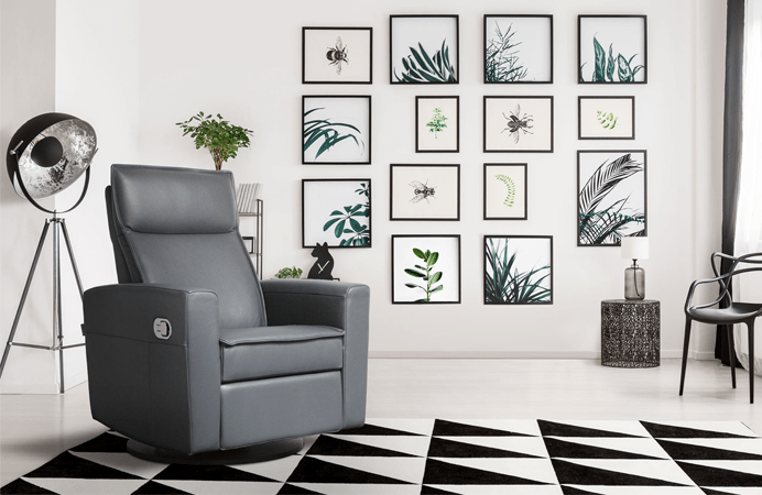 Living room interior design setting with grey recliner by contemporary Canadian furniture designer, Dutailier, over a black and white geometric rug with plant wall art