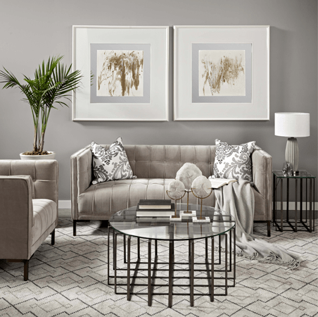 Living room interior design with beige couches and glass coffee table with framed abstract wall art by Mercana