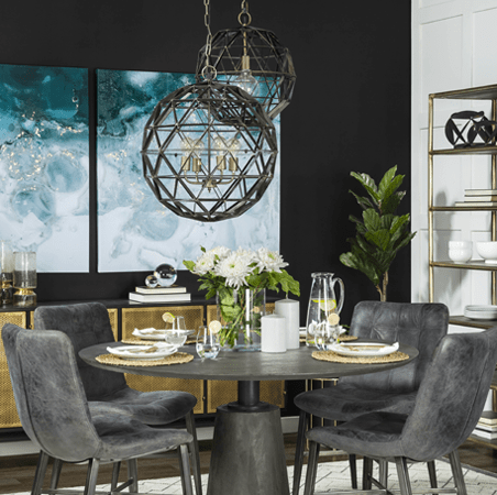 Grey dining room chairs in a dining room interior design with pendant light and blue canvas artwork by Mercana